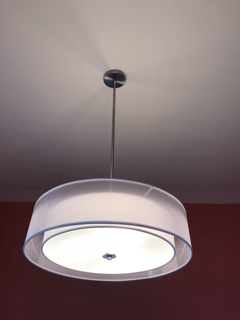 lit light hanging from the ceiling