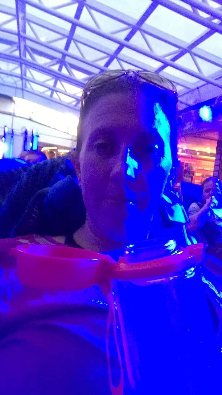 Brightly lit selfie by the pool on a cruise