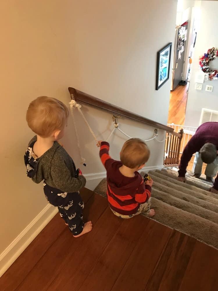 Boys on steps using rope railing