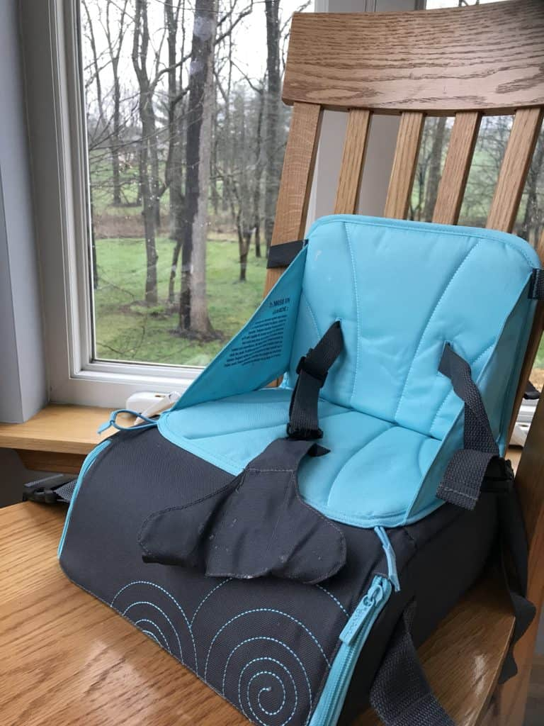 Blue and grey munchkin travel booster seat