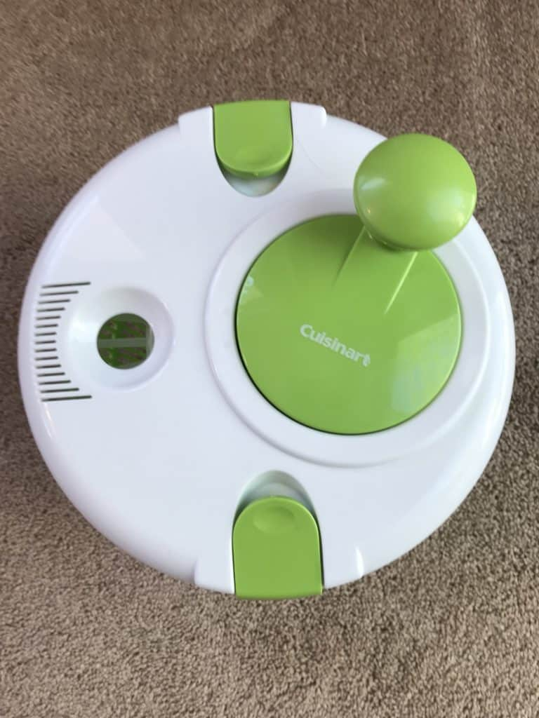 Cuisinart Salad Spinner in white and green on a beige rug background