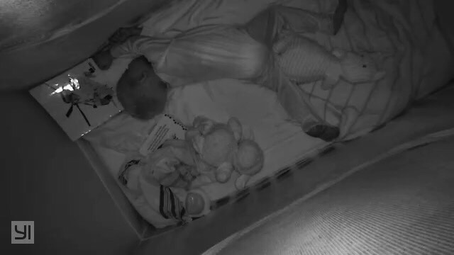 Black and white picture of a sleeping child