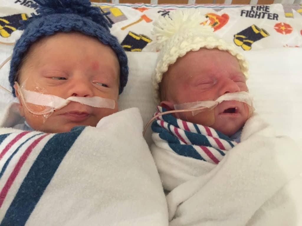 Fraternal twin preemies in the nicu with side eye