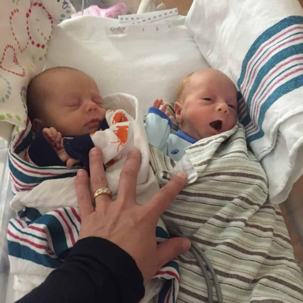 Fraternal Twin brothers in a bassinet