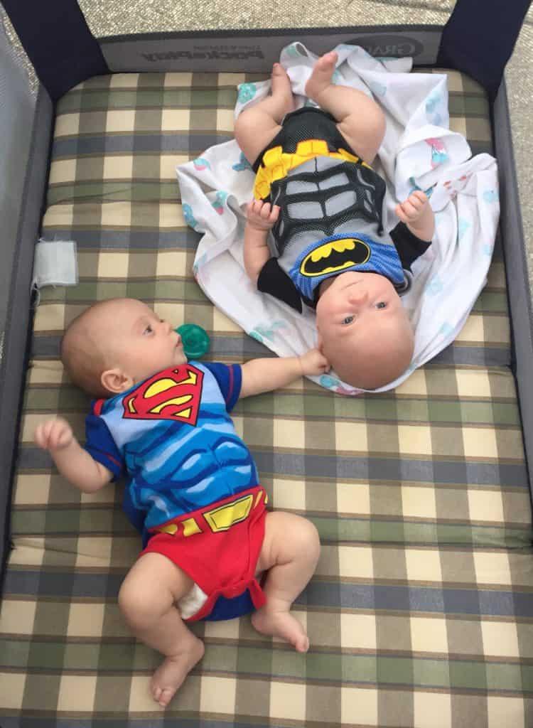 Twin boys in superhero onesies