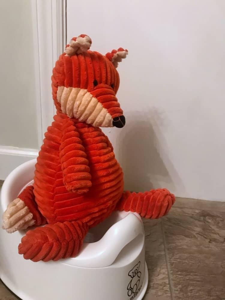 Fox sitting on a potty for potty training twins