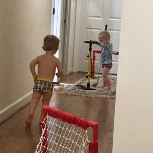 twin boys playing hockey