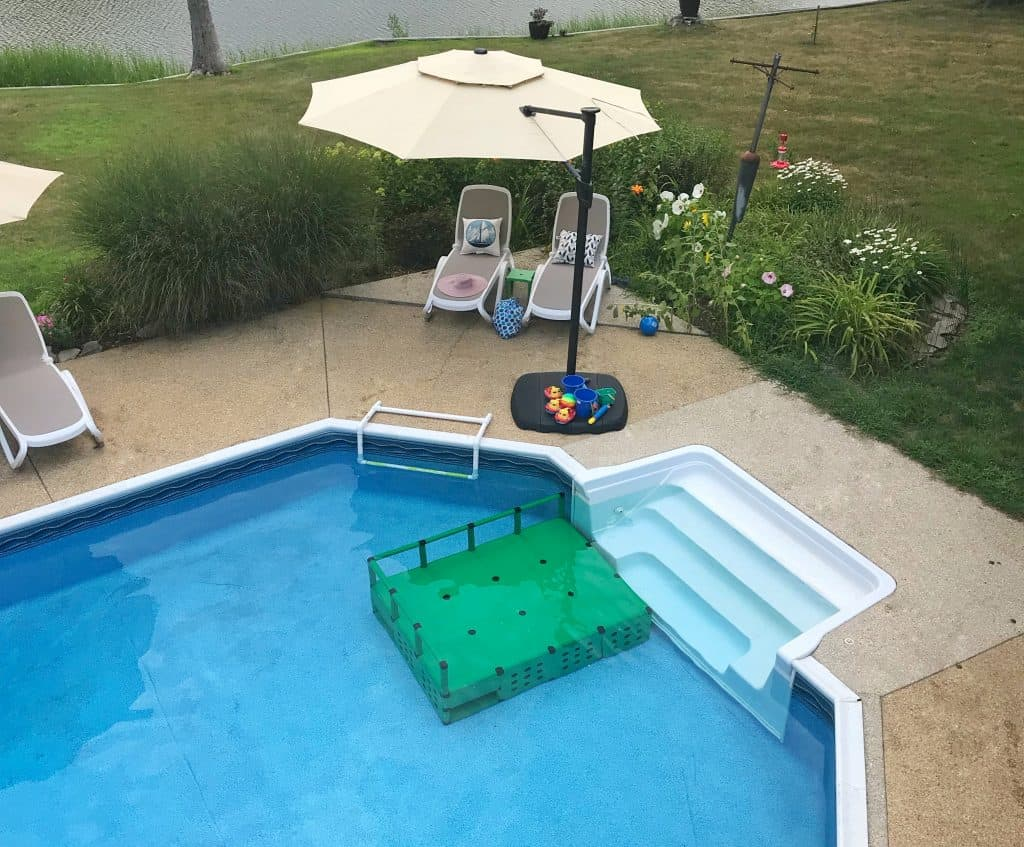 Pool Dock Quadro Aqua installed in a pool for expanded play area for toddler twins.