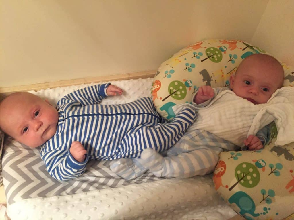 Fraternal Twin Brothers in coordinating outfits Blue Stripe Babies. Baby Boppy