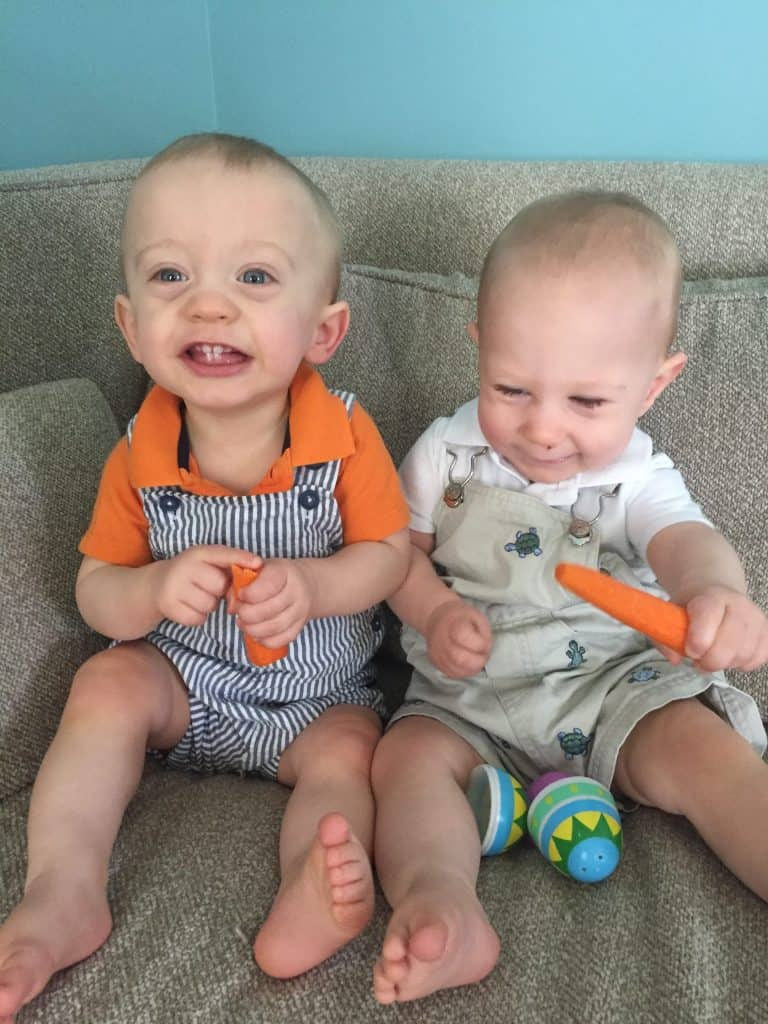Fraternal Twin Brothers in coordinating outfits carrots easter