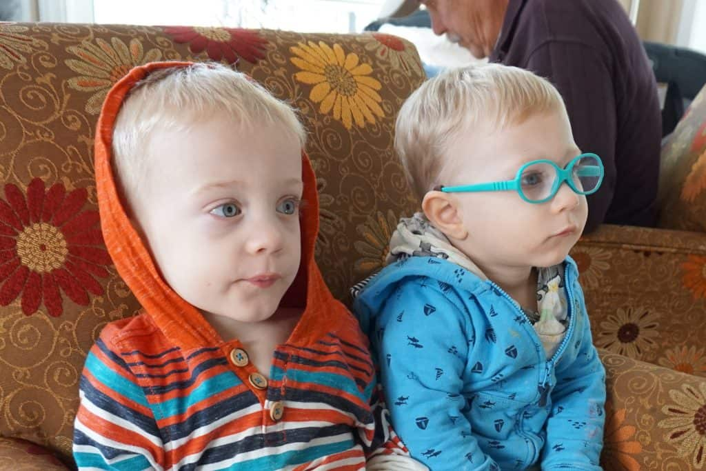 Twin brothers sitting honest talk for parents trying to ditch the diaper